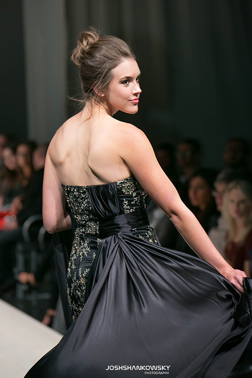 A model spins at the end of a cat walk allowing her dress to float.