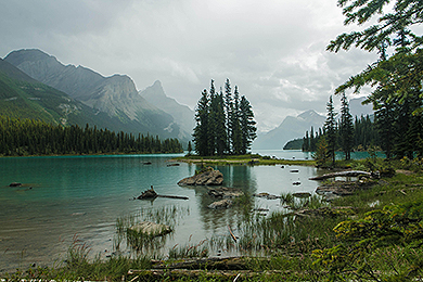 A photograph of Spirit Island in Jasper National Park on a foggy day.